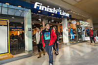 Last minute shoppers outside the Finish Line store in the Queens Center Mall in the borough of Queens in New York on Christmas Eve, Saturday, December 24, 2016. A study reports that the holiday shopping season, November and December, now accounts for less than 21 percent of physical stores' sales, down from its peak of 25 percent. (© Richard B. Levine)