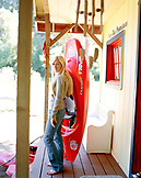 USA, California, portrait of a young woman holding kayak, Forks of Salmon, Otter Bar Kayaking School