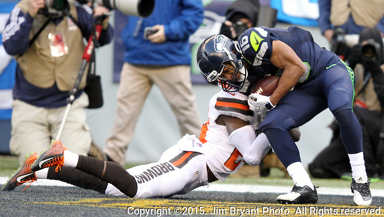 Seattle Seahawks wide receiver Tyler Lockett (16) catches a 27-yard touchdown against Cleveland Browns defensive back Johnson Bladesmosi (24) at CenturyLink Field in Seattle, Washington on December 20, 2015. The Seahawks clinched their fourth straight playoff berth in four seasons by beating the Browns 30-13.  ©2015. Jim Bryant Photo. All Rights Reserved.