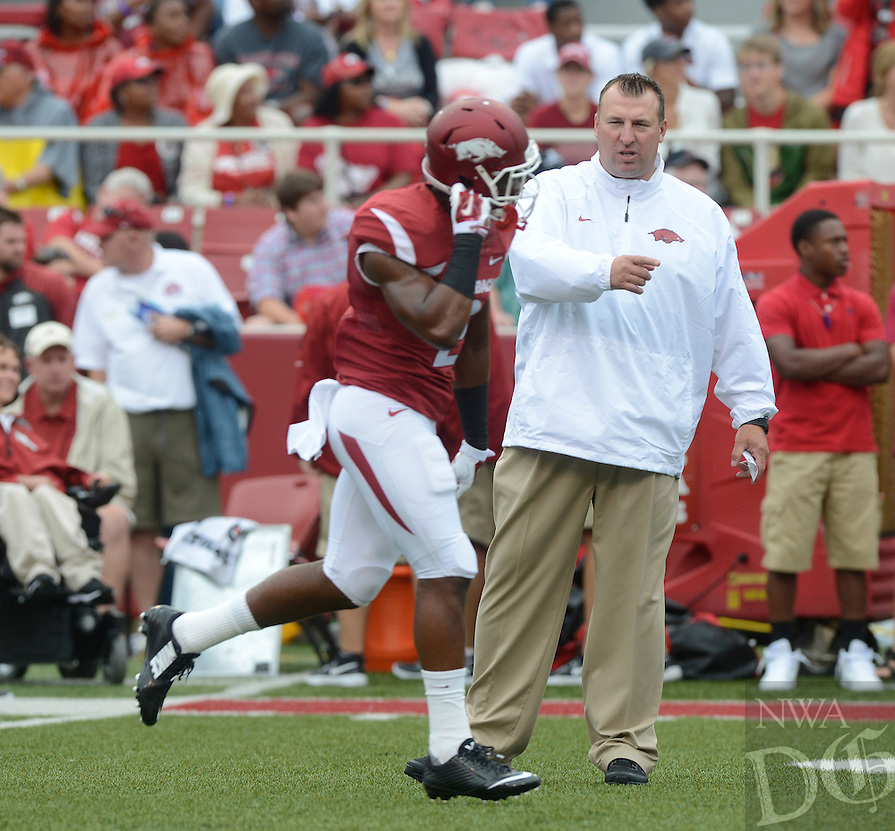 STAFF PHOTO ANTHONY REYES • @NWATONYR<br /> Bret Bielema, Arkansas head coach talks to a player against Nicholls State in the first quarter Saturday, Sept. 6, 2014 at Razorback Stadium in Fayetteville.