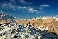"""Tucked at the edge of the Karakoram Mountains, the ruins of the Stone City are located at the north side of Taxkorgan (Tashgorgan) in the Tajik Autonomous County. Taxkorgan which means """"the stone castle"""" in the Uyghur language was located at the main junction of the middle and south sections of the ancient Silk Road. This is one of the most famous stone castles in Chinese history and is the gateway between China and Pakistan along the Karakoram Highway.."""