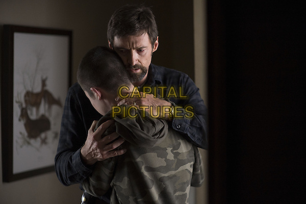 Dylan Minnette, Hugh Jackman<br /> in Prisoners (2013) <br /> *Filmstill - Editorial Use Only*<br /> CAP/NFS<br /> Image supplied by Capital Pictures