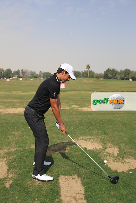 Matteo Manassero (ITA) on the practice range during Monday's Practice Day of the Commercial Bank Qatar Masters 2013 at Doha Golf Club, Doha, Qatar 21st January 2013 .Photo Eoin Clarke/www.golffile.ie