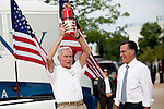 GOP presidential candidate Gov. Mitt Romney presents a fire extinghuisher, and a new truck, to supporter Jim Wilson at a campaign rally at EIT LLC, and electronics design and manufacturing company, in Sterling, Virginia, June 27, 2012.