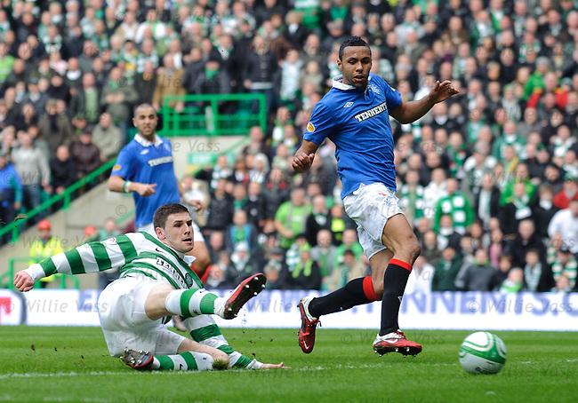 Gary Hooper slides in to score his second goal for Celtic