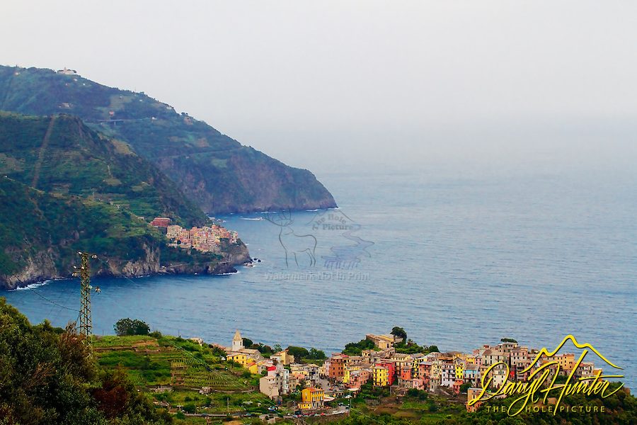 The villages of Corniglia and Riomaggiore on the rugged coast of  Cinque Terre, Italy