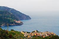 The villages of Corniglia and Riomaggiore on the rugged coast of  Cinque Terre, Italy