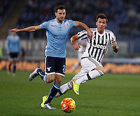 Calcio, Serie A: Lazio vs Juventus. Roma, stadio Olimpico, 4 dicembre 2015.<br /> Lazio&rsquo;s Stefan Radu, left, and Juventus&rsquo; Mario Mandzukic fight for the ball during the Italian Serie A football match between Lazio and Juventus at Rome's Olympic stadium, 4 December 2015.<br /> UPDATE IMAGES PRESS/Isabella Bonotto