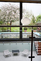 The open-plan house has been designed so that the outside and inside spaces are fully integrated with steps leading from the sunken terrace to the garden beyond