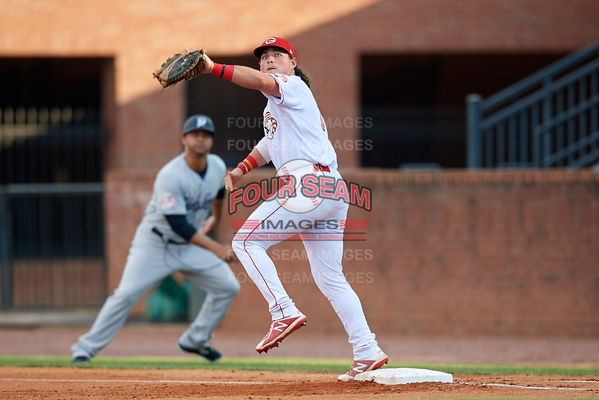 Greeneville Reds first baseman Rylan Thomas (37) stretches to receive a throw during a game against the Pulaski Yankees on July 27, 2018 at Pioneer Park in Tusculum, Tennessee.  Greeneville defeated Pulaski 3-2.  (Mike Janes/Four Seam Images)