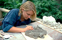 Artist age 32 making lizard at the Landscape Arboretum.  Chanhassen  Minnesota USA