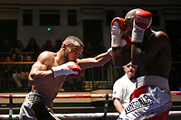 Philip Bowes (grey shorts) defeats Vusumzi Tyatyeka during a Boxing Show at York Hall on 10th February 2018