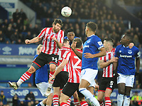 Lincoln City's Michael Bostwick heads clear under pressure from Everton's Ademola Lookman<br /> <br /> Photographer Andrew Vaughan/CameraSport<br /> <br /> Emirates FA Cup Third Round - Everton v Lincoln City - Saturday 5th January 2019 - Goodison Park - Liverpool<br />  <br /> World Copyright &copy; 2019 CameraSport. All rights reserved. 43 Linden Ave. Countesthorpe. Leicester. England. LE8 5PG - Tel: +44 (0) 116 277 4147 - admin@camerasport.com - www.camerasport.com