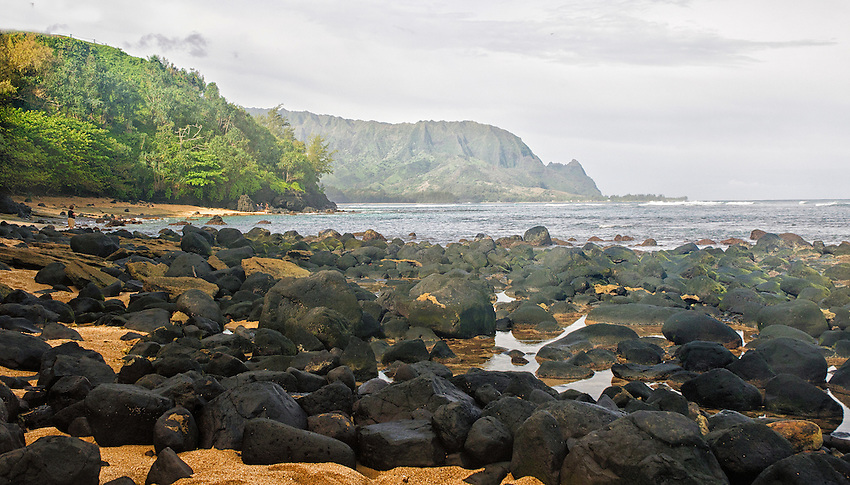 Rocky beach at Hanalei Bay on the north coast of Kauai, Hawaii