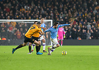 27th December 2019; Molineux Stadium, Wolverhampton, West Midlands, England; English Premier League, Wolverhampton Wanderers versus Manchester City; Romain Saiss of Wolverhampton Wanderers holding back Bernardo Silva of Manchester City whilst he is running with the ball