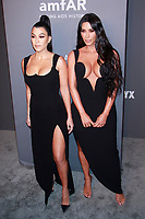 NEW YORK, NY - FEBRUARY 6: Kourtney Kardashian and Kim Kardashian West arriving at the 21st annual amfAR Gala New York benefit for AIDS research during New York Fashion Week at Cipriani Wall Street in New York City on February 6, 2019. <br /> CAP/MPI99<br /> &copy;MPI99/Capital Pictures