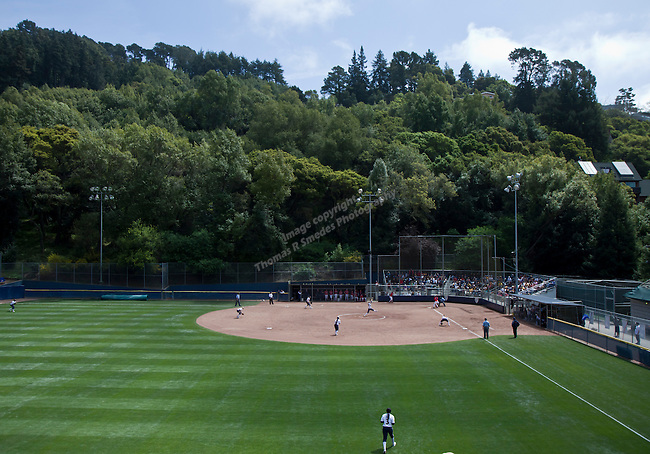 April 15, 2012:  California Bears Jolene Henderson throws against the Arizona Wildcats during their NCAA softball game played at beautiful Levine-Fricke Field on Sunday afternoon in Berkeley, California.  California won the game 6-0.