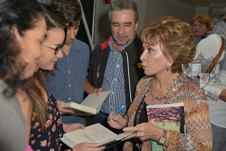 MIAMI, FL - NOVEMBER 15: Isabel Allende (R), Fernando De Achurra and Aitor De Achurra attend The Miami Book Fair at Miami Dade College Wolfson - Chapman Conference Center on November 15, 2017 in Miami, Florida.( Photo by Johnny Louis / jlnphotography.com )
