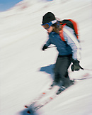 ARGENTINA, Bariloche, blurred motion person skiing on snow capped mountain