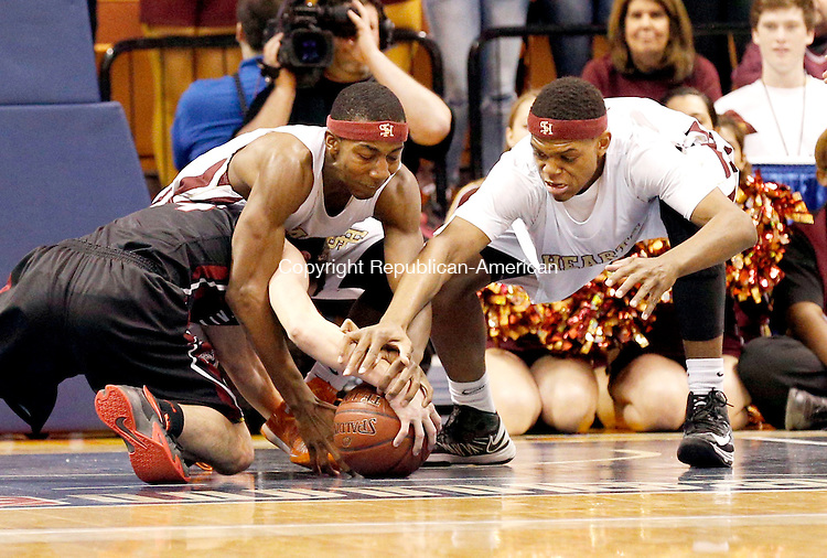 Uncasville, CT- 22 March 2015-032215CM21- Sacred Heart's Charles Fisher, left, and Malik Petteway go after the ball against Valley Regional's David Bradbury during the Class S state championship game at Mohegan Sun Arena in Uncasville on Sunday.  The Hearts won, 71-46.   Christopher Massa Republican-American