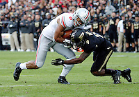 Ohio State Buckeyes wide receiver Evan Spencer (6) gets tackled by Purdue Boilermakers defensive back Anthony Brown (9) after making a catch during the first half of the NCAA football game at Ross-Ade Stadium in West Lafayette, Ind. on Nov. 2, 2013. (Adam Cairns / The Columbus Dispatch)