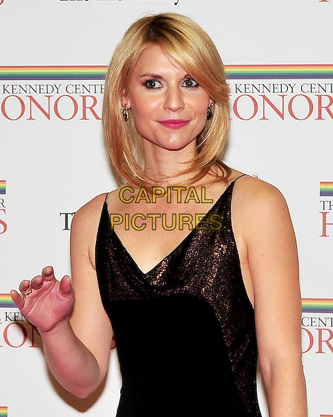 Claire Danes .The formal Artist's Dinner at the United States Department of State in Washington, D.C., USA..December 4th, 2010.half length brown sparkly dress hand .CAP/ADM/RS.©Ron Sachs/CNP/AdMedia/Capital Pictures.