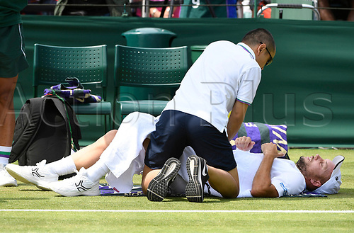 July 6th 2017, All England Lawn Tennis and Croquet Club, London, England; The Wimbledon Tennis Championships, Day 4;  Steve Darcis of Belgium has his injury looked at