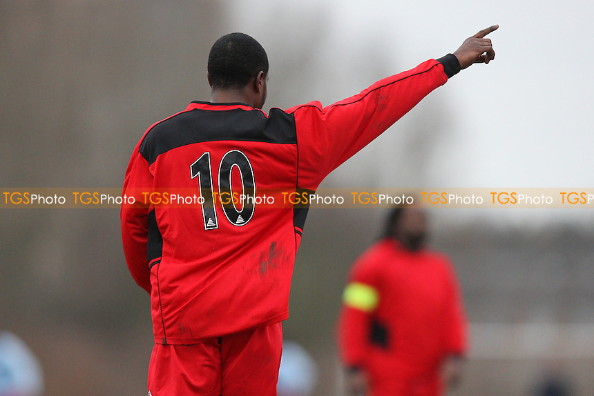 Red Devils (red/black) vs The Comets - Hackney & Leyton Sunday League Dickie Davies Cup Football at South Marsh, Hackney Marshes, London - 08/01/12 - MANDATORY CREDIT: Gavin Ellis/TGSPHOTO - Self billing applies where appropriate - 0845 094 6026 - contact@tgsphoto.co.uk - NO UNPAID USE.