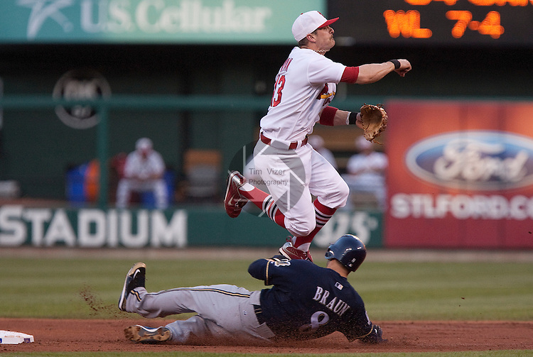 July 1, 2010        St. Louis Cardinals shortstop Brendan Ryan (13) leaps over a sliding Milwaukee Brewers left fielder Ryan Braun (8) to make the double play throw to first base.  The St. Louis Cardinals defeated the Milwaukee Brewers 5-0 in the second game of a four-game homestand at Busch Stadium in downtown St. Louis, MO on Friday July 2, 2010.