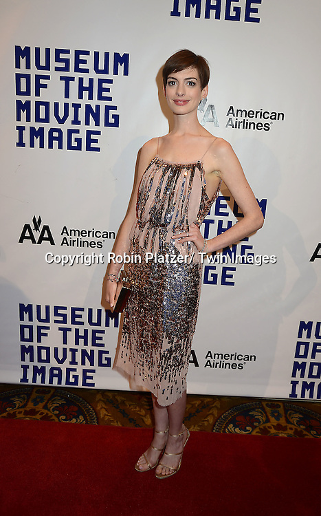 Anne Hathaway in Nina Ricci beige and silver dress attends the Museum of the Moving Image Salute to Hugh Jackman on December 11,2 012 at Cipriani Wall Street in New York City.