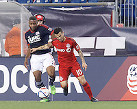 Foxborough, Massachusetts - May 16, 2015: In a Major League Soccer (MLS) match, the New England Revolution (blue/white) tied Toronto FC (red), 1-1, at Gillette Stadium.