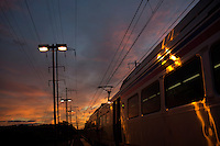 A SEPTA commuter train stops at dusk at Cornwells Heights Station on the Trenton Line in Bensalem, Pennsylvania.
