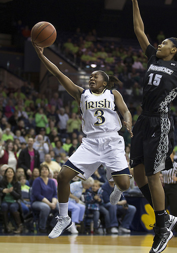 January 26, 2013:  Notre Dame guard Whitney Holloway (3) goes up for a shot as Providence forward Chanise Baldwin (15) defends during NCAA Basketball game action between the Notre Dame Fighting Irish and the Providence Friars at Purcell Pavilion at the Joyce Center in South Bend, Indiana.  Notre Dame defeated Providence 89-44.