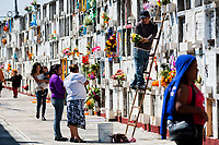 Mexican families bring flowers to the cemetery to honor their deceased relatives during the Day of the Dead festivities in Morelia, Michoacán, Mexico, 2 November 2014. Day of the Dead ('Día de Muertos') is a syncretic religious holiday, celebrated throughout Mexico, combining the death veneration rituals of the ancient Aztec culture with the Catholic practice. Based on the belief that the souls of the departed may come back to this world on that day, people gather on the gravesites praying, drinking and playing music, to joyfully remember friends or family members who have died and to support their souls on the spiritual journey.