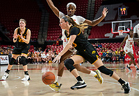 COLLEGE PARK, MD - FEBRUARY 13: Makenzie Meyer #3 of Iowa dribbles past Kaila Charles #5 of Maryland during a game between Iowa and Maryland at Xfinity Center on February 13, 2020 in College Park, Maryland.
