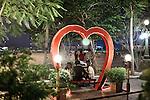 PHNOM PHEN, CAMBODIA, APRIL 2013:<br />Diamond Island e' anche il luogo nuovo dove le coppiette vengono a passare i loro momenti piu' intimi ed a fantasticare sul loro matrimonio.<br />L'alta borghesia khmer festeggia al Diamond Island Convention &amp; Exhibition Center, nuovo complesso creato su Koh Pich (Diamond Island), isola fluviale nel centro di Phnom Penh che nel sogno degli azionisti della Canadia Bank (tra cui, si mormora, la famiglia di Hun Sen, primo ministro in carica dal 1985) dovrebbe divenire una micro Singapore. Le dieci sale di Diamond Island possono accogliere un totale di 2000 persone, ma le tariffe sono molto pi&ugrave; alte: il minimo &egrave; di 250 dollari per un tavolo da dieci (cena compresa), la media di circa 400. &copy; Giulio Di Sturco per &quot;D&quot; della Repubblica