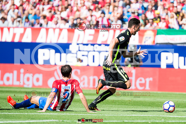 Atletico de Madrid's player Diego Godín and Sporting de Gijon's Burgui during a match of La Liga Santander at Vicente Calderon Stadium in Madrid. September 17, Spain. 2016. (ALTERPHOTOS/BorjaB.Hojas) /NORTEPHOTO