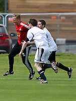 Pictured: Garry Monk pulled back by Chris Barney. Tuesday 06 May 2014<br />