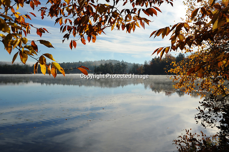 Early Morning Mist on a Quiet Island Pond in Stoddard, New Hampshire USA
