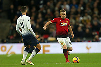 Luke Shaw of Manchester United and Erik Lamela of Tottenham Hotspur during Tottenham Hotspur vs Manchester United, Premier League Football at Wembley Stadium on 13th January 2019