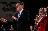 MITT ROMNEY, with wife ANN, right, delivers a speech following the Iowa caucus Tuesday, January 3, 2012 in Des Moines, Iowa.
