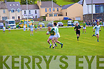 South Kerry's Aidan 'Dash' O'Sullivan and Kevin O'Shea battle it out for possession in front of St Kiernans goal.