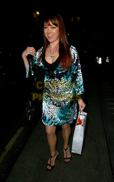 LISA SCOTT-LEE .At the OK Celebrity Secrets Party at Studio Valbonne, London, UK..March 8th 2007.full length black white pattern dress green satin scott lee goody bag purse.AP/CAN.©Can Nguyen/Capital Pictures