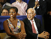 First Lady Michelle Obama sits with Norman Francis, president of Xavier University in New Orleans, Louisiana, Sunday, August 29, 2010, as United States President Barack Obama prepares to speak. President Obama was at the University to give a speech marking the fifth anniversary of Hurricane Katrina.  .Credit: A.J. Sisco - Pool via CNP
