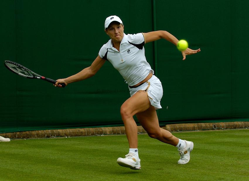 Photo: Richard Lane..Wimbledon Championships. 27/06/2006..Italy's Tathiana Garbi returns.
