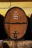 An old wooden storage vat in the winery. Domaine Viret, Saint Maurice sur Eygues, Drôme Drome France, Europe