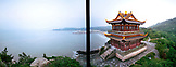 CHINA, Putou Shan, elevated view of Buddhist temple with Thousand Steps Beach in the distance