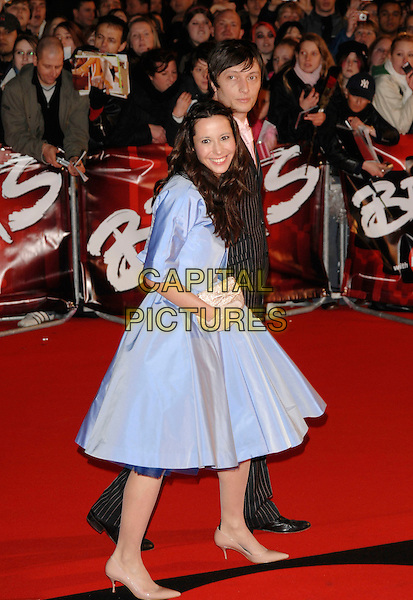 NERINA PALLOT & GUEST.The Brit Awards arrivals at Earl's Court, London England. .14th February 2007.brits full length blue satin dress gloves clutch purse.CAP/PL.©Phil Loftus/Capital Pictures