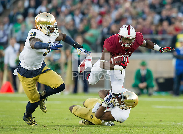 STANFORD, CA - November 30, 2013: Stanford Cardinal wide receiver Ty Montgomery (7) during the Stanford Cardinal vs the Notre Dame Irish at Stanford Stadium in Stanford, CA. Final score Stanford Cardinal 27, Notre Dame Irish  20.