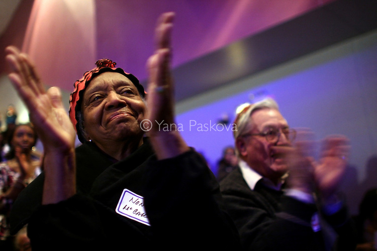 "(L-R) Nona McCall, 78, retired accountant, and Donald Baskin, 76, retired social worker, (both from Chicago,) applaud while watching the inauguration of Barack Obama as President of the United States in the theater of the DuSable Museum of African-American History in Chicago, Illinois, on the Presidential Inauguration Day, Tuesday, January 20, 2009.  Baskin said of Obama, ""I expect him to be one of the greatest presidents in history."" Baskin's phone number is: 773.288.0707 (Photo by Yana Paskova for The New York Times)..Assignment ID: 30075164A"